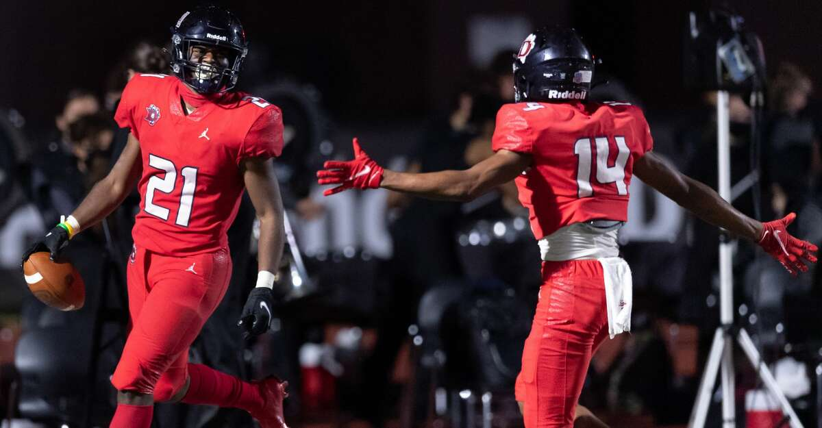 Ja'Den Stewart (21) of the Dawson Eagles celebrates his touchdown in the second half against the Dickinson Gators with Raynard Allen (14) during a High School bi-district playoff football game on Thursday, December 10, 2020 at Pearland ISD Stadium in Pearland, Texas.