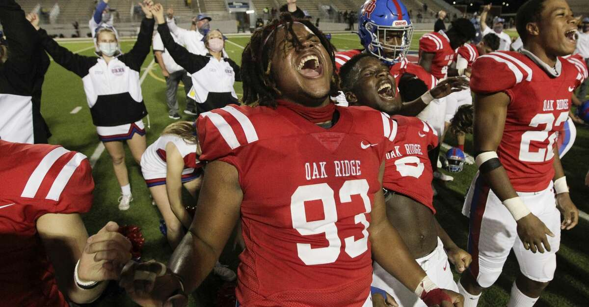 Oak Ridge defensive tackle Jacob Harris (93) celebrates after the team's 30-20 win over Aldine Eisenhower during a Region II-6A bi-district high school playoff game at Woodforest Bank Stadium, Dec. 10, 2020, in Shenandoah.