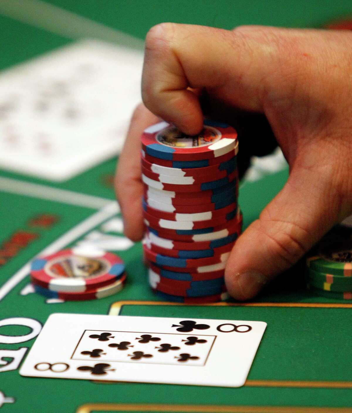 A file photo of a dealer handling chips at a casino.