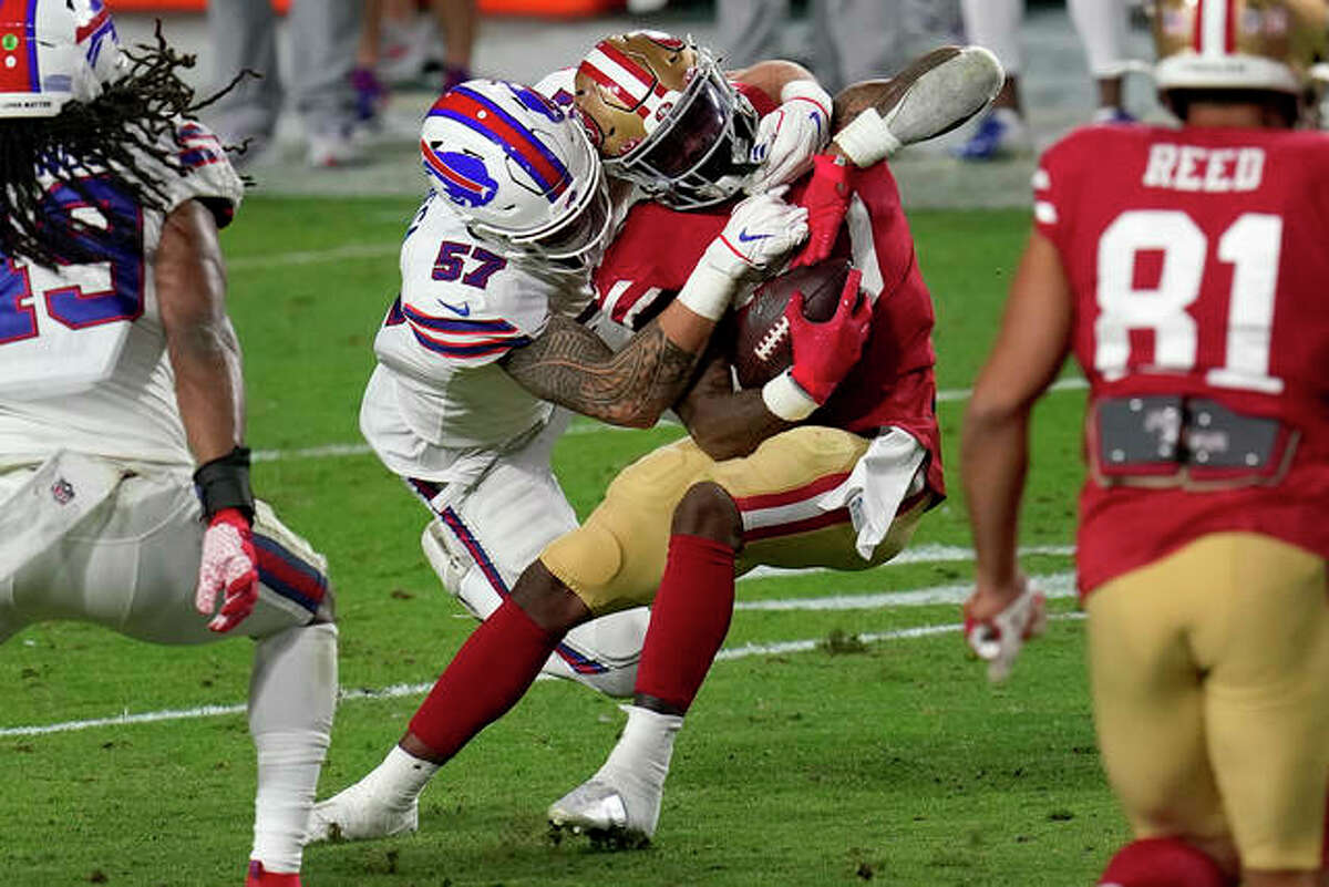 San Francisco 49ers running back Jeff Wilson (30) is hit by Buffalo Bills defensive end A.J. Epenesa (57) during the second half of an NFL football game, Monday, Dec. 7, 2020, in Glendale, Ariz.