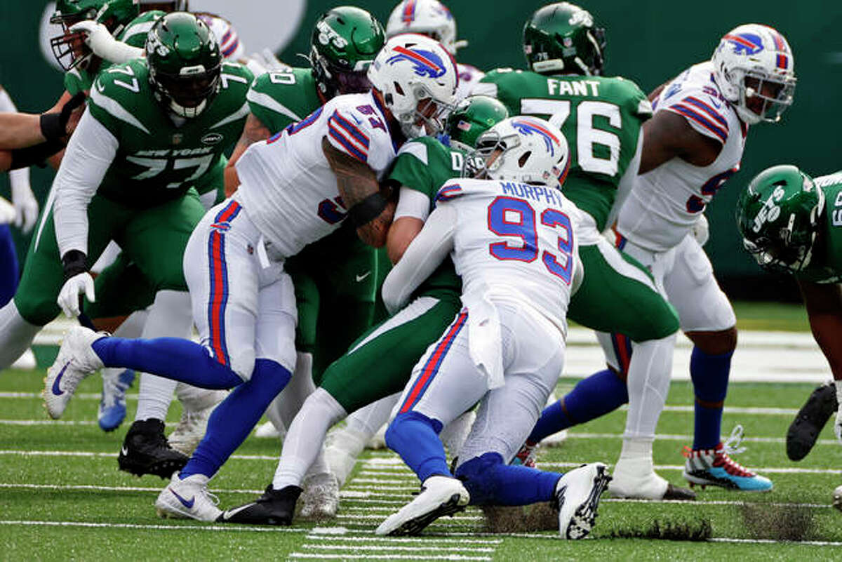 New York Jets quarterback Sam Darnold (14) is sacked by Buffalo Bills defensive end Trent Murphy (93) and Buffalo Bills defensive end A.J. Epenesa (57) during an NFL football game, Sunday, Oct. 25, 2020, in East Rutherford, N.J.