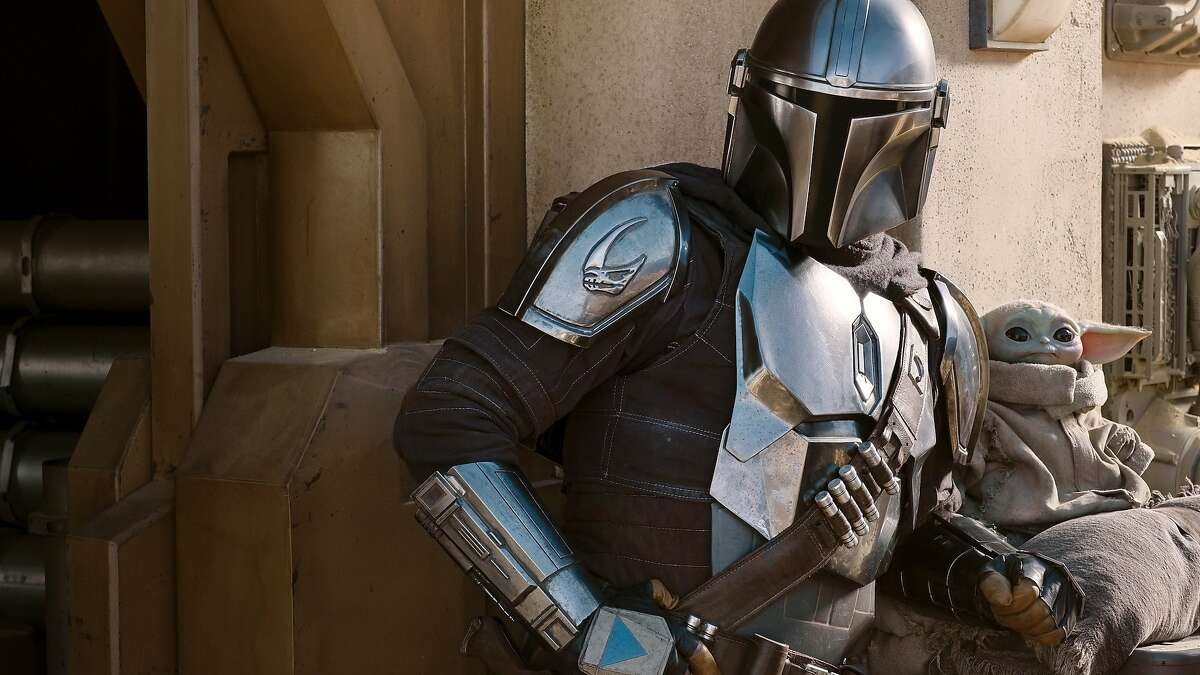 The Mandalorian (Pedro Pascal) and the Child (aka Baby Yoda) in a still from season two of