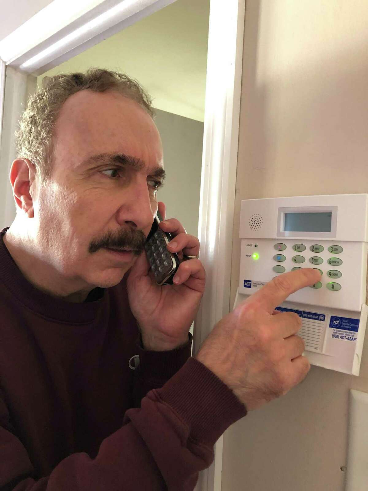 Jerry Zezima tests out his home alarm system.