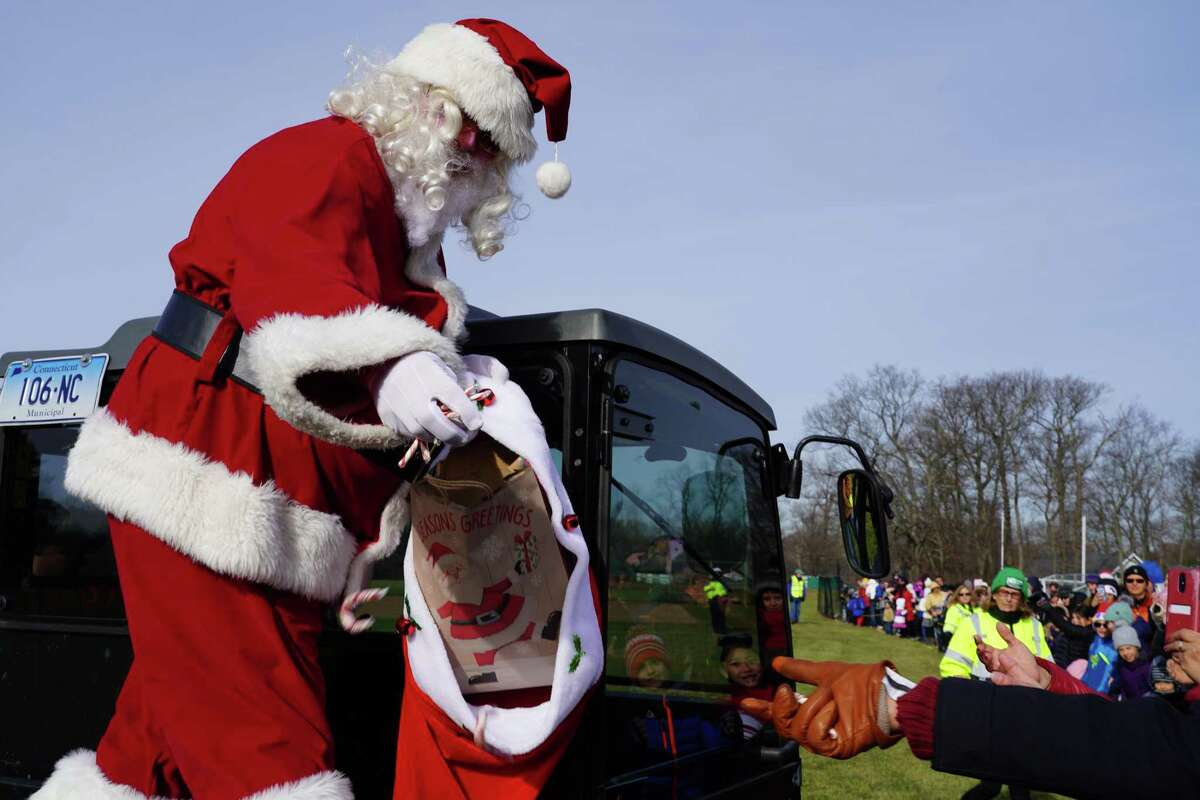 Santa Claus lands by helicopter in one of New Canaan's parks, Waveny Park, 677 South Ave., during a previous December. Santa Claus is coming to town on Saturday, Dec. 12 from 9 to 11 a.m., and is going to be making an appearance at the Waveny House in the park. Cars will line up upon Santa's arrival.