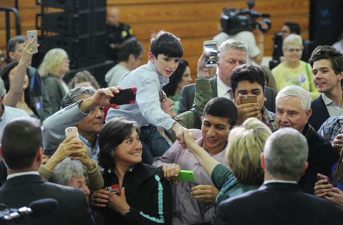Supporters clamor to shake hands and take pictures with Democratic presidential candidate Hillary Clinton during a primary campaign rally at the University of Bridgeport in April 2016.