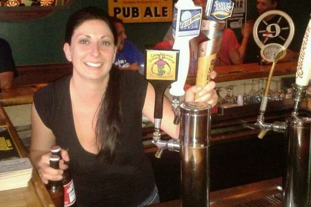 Kristine Casey on her opening day at Casey's Irish Pub in Milford. Casey's business was strong - until the pandemic closed the neighborhood bar where everyone is like family.
