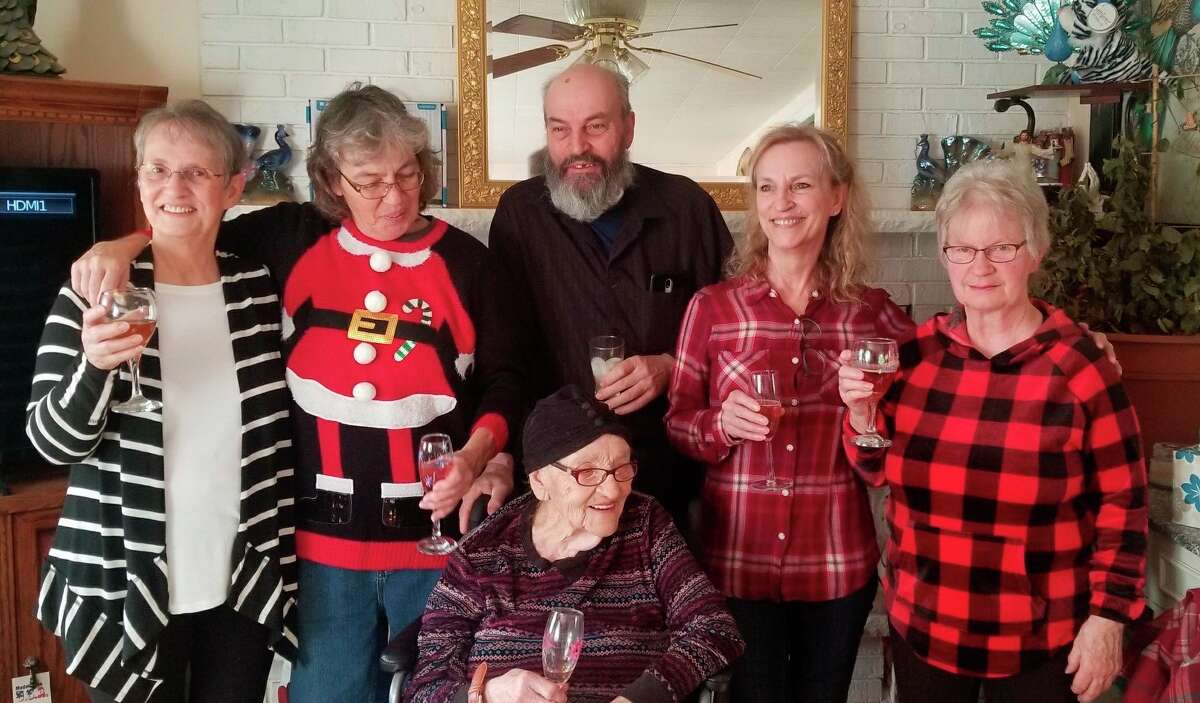 Toasting to the season with champagne and chocolates, a tradition with my 97-year-old mother (center) and a few of my sisters and brothers, from left, Patty, Rita Mae, Danny Ray, and Sharon (far right).