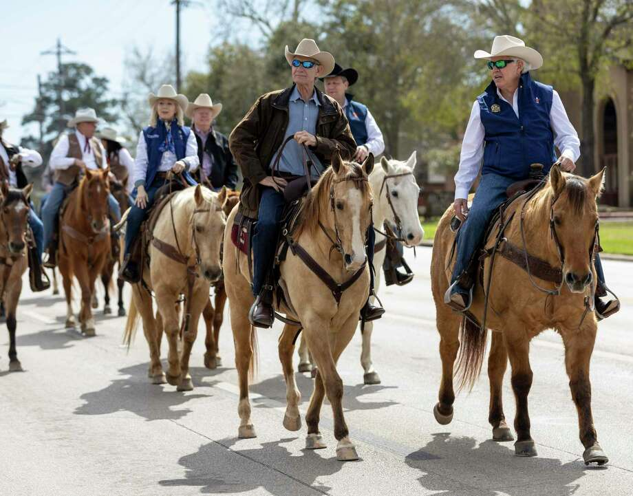Members of the Houston Live Stock and Rodeo ride horses along the parade route at the 2020 Go Texan Parade in downtown Conroe. The annual Conroe Go Texan parade has been canceled due to the ongoing COVID-19 pandemic. Photo: Gustavo Huerta, Houston Chronicle / Staff Photographer / Houston Chronicle © 2020