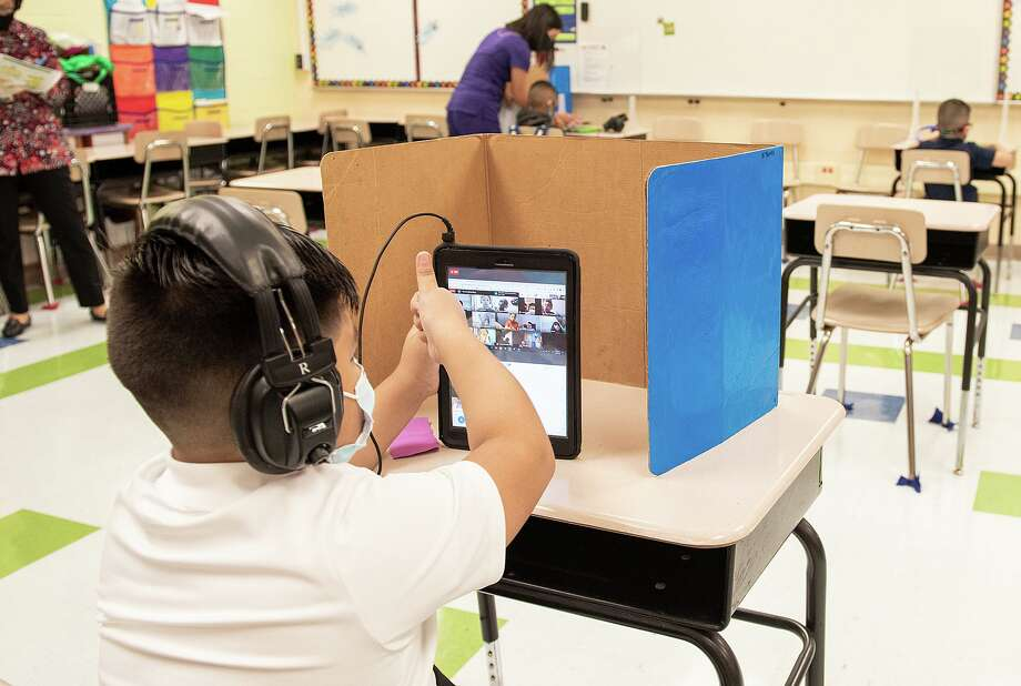 M.S. Ryan Elementary student Elias Lozano checks in with his teacher in his virtual classroom on Aug. 24 during the first day back to school for some students during the COVID-19 pandemic. Photo: Danny Zaragoza /Laredo Morning Times File