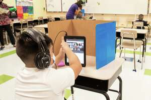 M.S. Ryan Elementary student Elias Lozano checks in with his teacher in their virtual classroom on Aug. 24, 2020 during the first day back to school for some students.