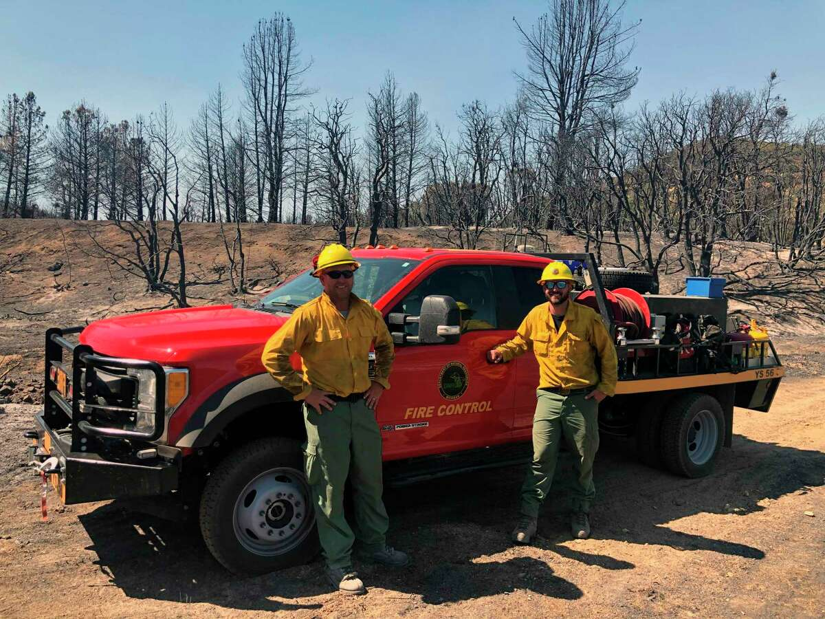 Paul Dunn and Ben Osterland, two Michigan Department of Natural Resources firefighters, drove an off-road fire truck from Michigan to California to help with the Lake Fire outside of Los Angeles. (Michigan Department of Natural Resources/Courtesy Photo)