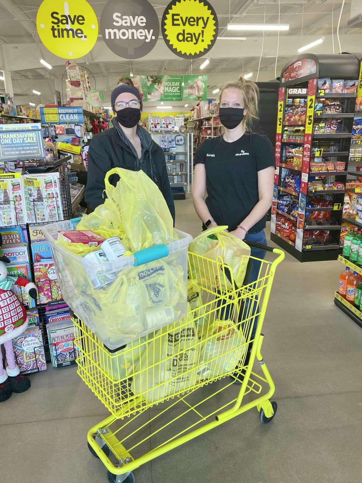 Employees from the Dollar General in Rodney stand with the many items the store recently donated to the Manna Pantry of Big Rapids. (Courtesy photo)