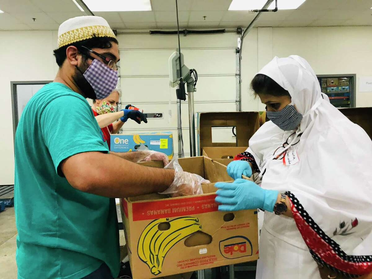 """Members of the Dawoodi Bohra community of The Woodlands shown assorting food packages, regularly volunteers with the Montgomery County Food Bank, as well as raises funds and collects food. The Dawoodi Bohra community of Houston is similarly teaming up with Lifepath Church to hold a """"Rise Against Hunger"""" food packaging event on Sunday, Dec. 13 from 12:30- 3 p.m., at Masjid-E-Mohammedi."""