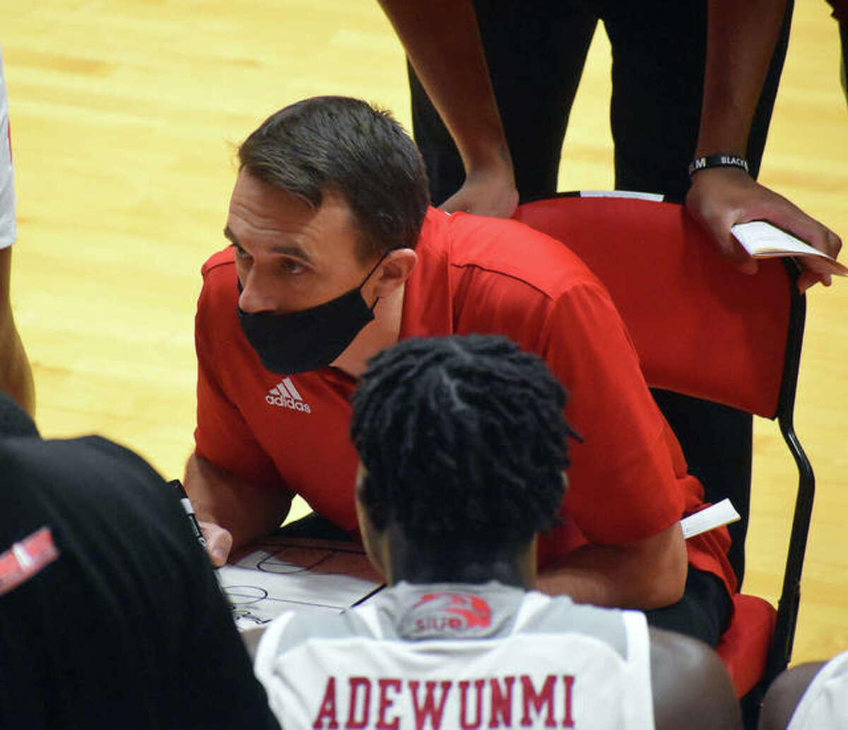 SIUE coach Brian Barone talks to his team during a timeout in the second half of Saturday's game against the University of Nebraska-Omaha inside First Community Arena.