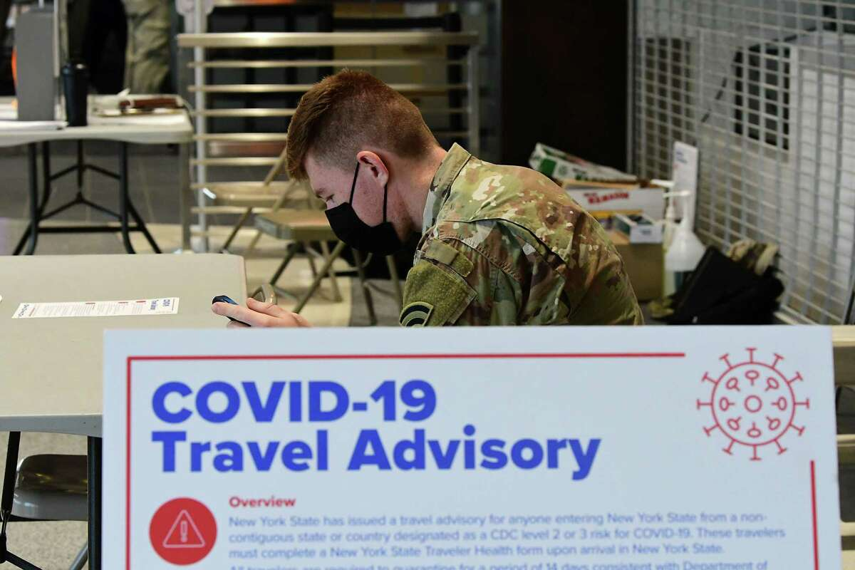 A table is set up for health screen forms at the Albany International Airport on Friday, Dec. 11, 2020 in Colonie, N.Y. (Lori Van Buren/Times Union)