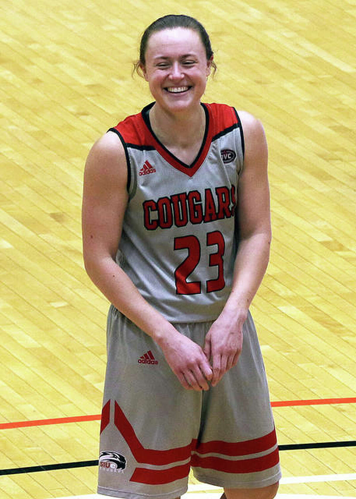 SIUE's Allie Troeckler enjoys a light moment with at teammate before completing a three-point play during Wednesday's victory over UHSP at First Community Arena in Edwardsville.