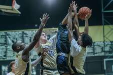 Just about every play was a struggle for both teams as the Nederland Bulldogs took down the Hamshire-Fannett Longhorns in a physical basketball matchup Saturday night in Nederland. Photo made on December 5, 2020. Fran Ruchalski/The Enterprise