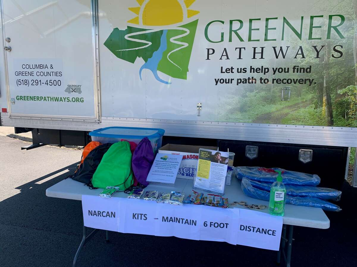Greener Pathways' mobile outreach table, offering Narcan kits and other drug user support during the COVID-19 pandemic, in Chatham, N.Y.