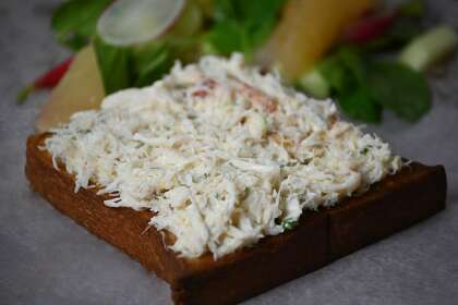 Griddled brioche topped with Dungeness crab is on the menu at Billingsgate in San Francisco.