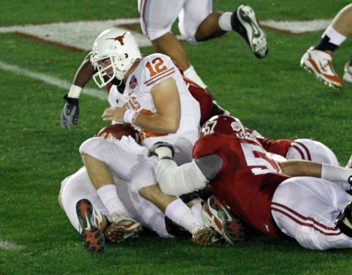 Texas quarterback Colt McCoy (12) is tackled by Alabama defenders during the first quarter of the BCS Championship Game in Pasadena, Calif., on Jan. 7, 2010. McCoy left the game after the play.