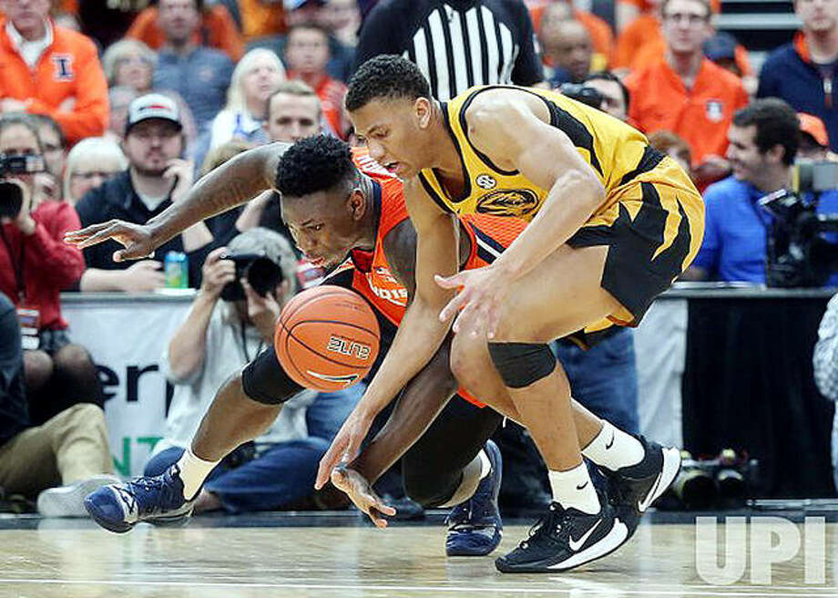 Missouri's Javon Pickett, right, and Illinois' Kofi Cockburn go to the floor in an effort to get the loose basketball during last year's Braggin' Rights game at the Enterprise Center in St. Louis. This year's game will be played at Mizzou Saturday. It was moved from St. Louis because of the COVID-19 pandemic. Photo: Bill Greenblatt, UPI | For The Telegraph