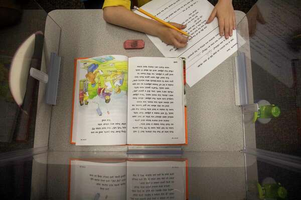 Students practice reading skills Friday, Dec. 11, 2020 at IDEA Travis Elementary. Jacy Lewis/Reporter-Telegram