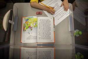 Students practice reading skills Friday, Dec. 11, 2020 at IDEA Travis Elementary.   Jacy Lewis/Reporter-Telegram