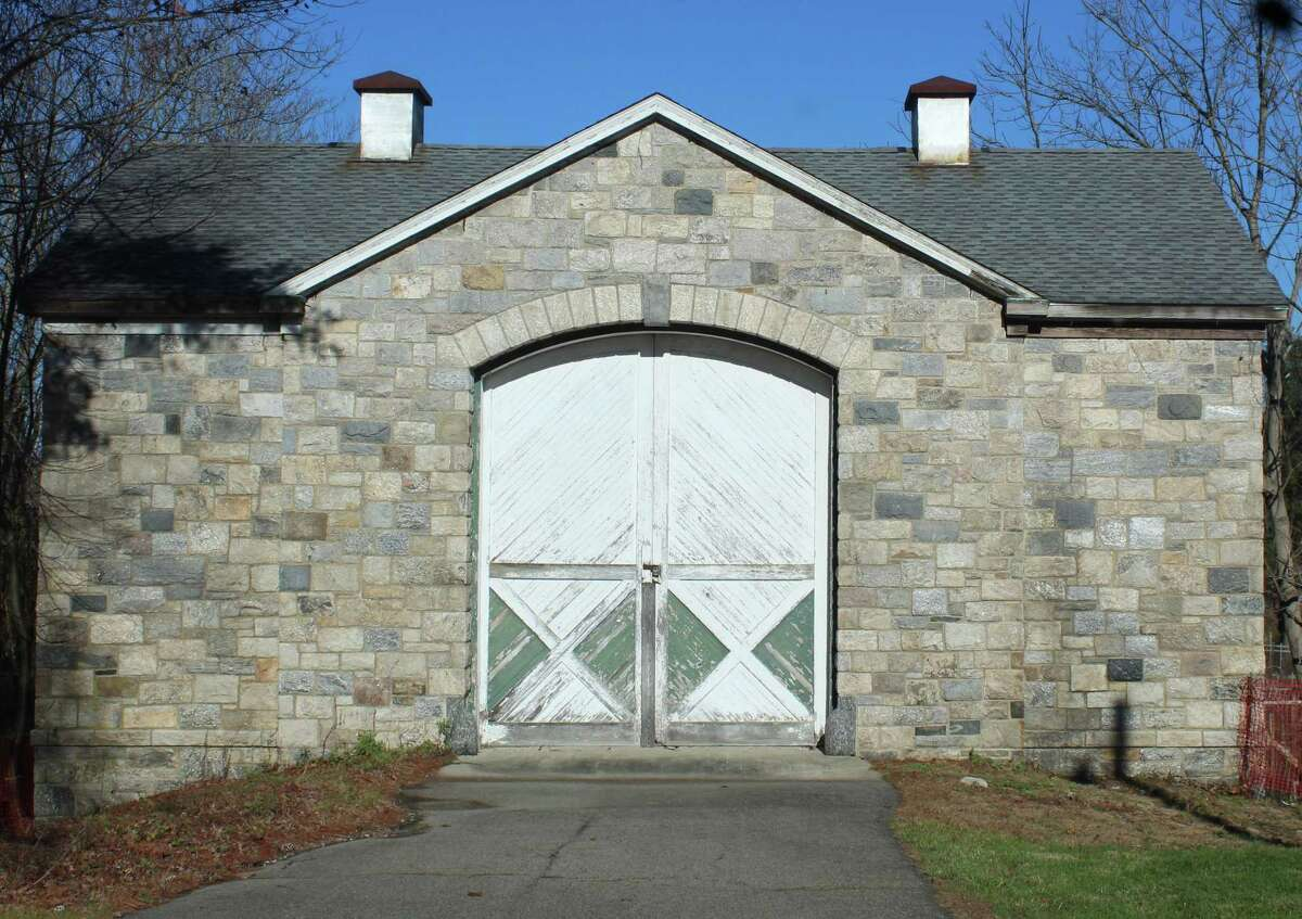 The former barn on the grounds of Scofield Manor in Stamford, Connecticut, which was once used as a work farm for the city's neediest residents. The facility contains dozens of grave makers made for nearby Potter's Field.