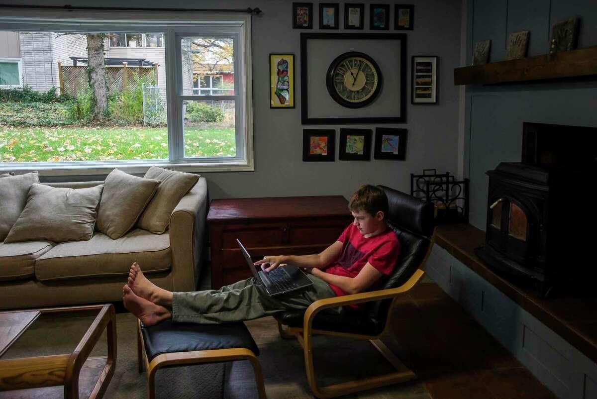 Virtual Academy student Sean Surbrook works on schoolwork Thursday, Oct. 29, 2020 at home in Midland. (Katy Kildee/kkildee@mdn.net)