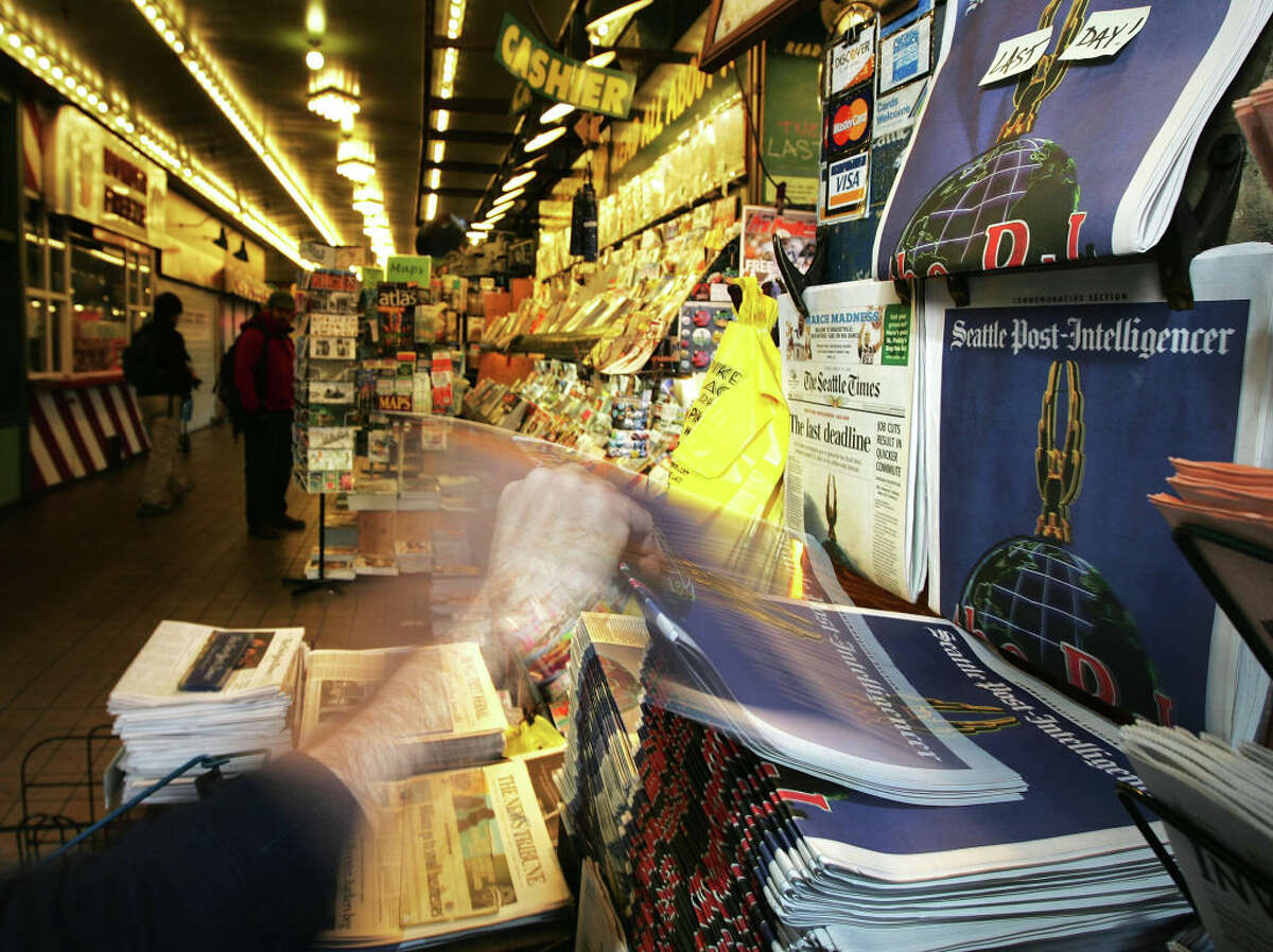 SEATTLE - MARCH 17: A customer picks up the last ever printed issue of the Seattle Post-Intelligencer at First & Pike News on March 17, 2009 in Seattle, Washington. The Seattle paper will continue to publish online becoming the nation's largest daily newspaper to move to an entirely internet only based news source. (Photo by Robert Giroux/Getty Images)