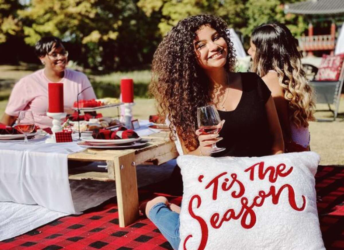 For $65, customers can book a Christmas picnic package that includes the table set-up for two, blanket and pillows, festive decor, hot cocoa bar and individual treat boxes. Additional plates are available as an add-on feature.