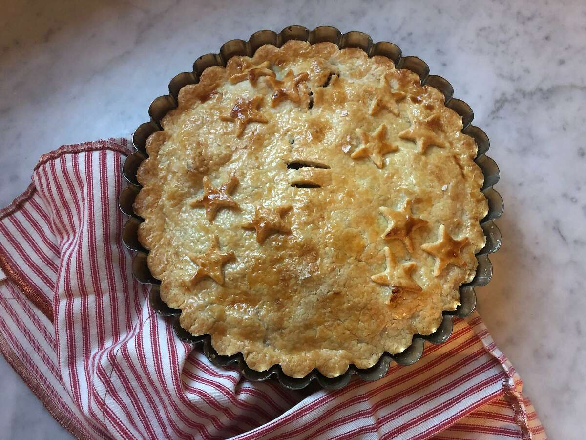 Tourtiere is a French Canadian spiced meat pie typically served on Christmas Eve.