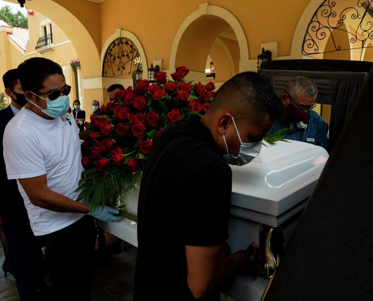 Pallbearers carry Trancito Rangel's casket into the back of a hearse during his funeral service at Compean Funeral Home on Tuesday, Aug. 4, 2020, in Houston. Rangel, 46, was a construction worker who died of COVID-19.