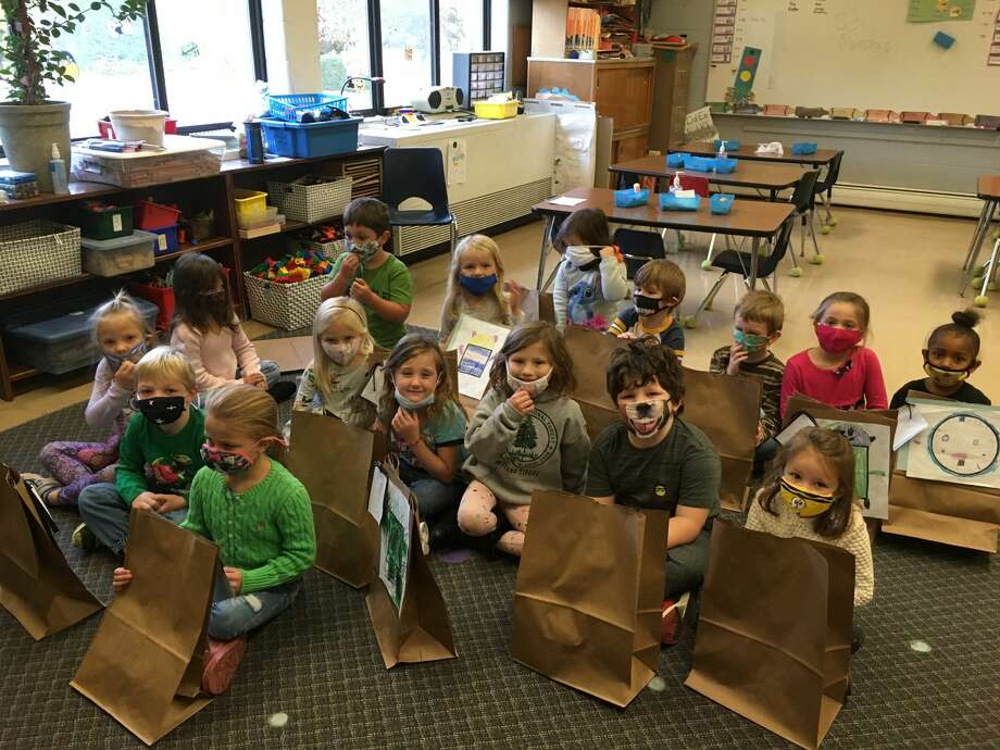 Allison Veine's kindergarten class waits to open monster dolls that were created based off drawings they made. The dolls were made by Sara Workman's community based instruction class. Photo: Courtesy Photo