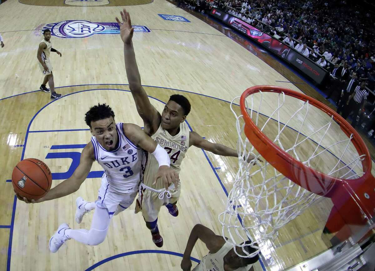 Spurs guard Tre Jones, formerly of Duke, drives to the basket against Devin Vassell, whom the Spurs drafted out of Florida State, during the championship game of the 2019 Men's ACC Basketball Tournament at Spectrum Center on March 16, 2019 in Charlotte, North Carolina.