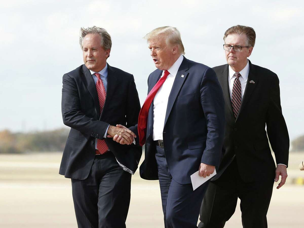 President Donald Trump meets with Texas Attorney General Ken Paxton, left, and Lt. Gov. Dan Patrick on Nov. 20. Paxton has failed to uncover voter fraud, but it's not for a lack of effort.