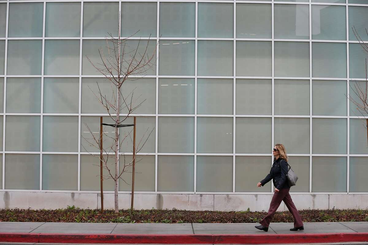 A woman walks through the Oracle campus in Redwood City in 2018.