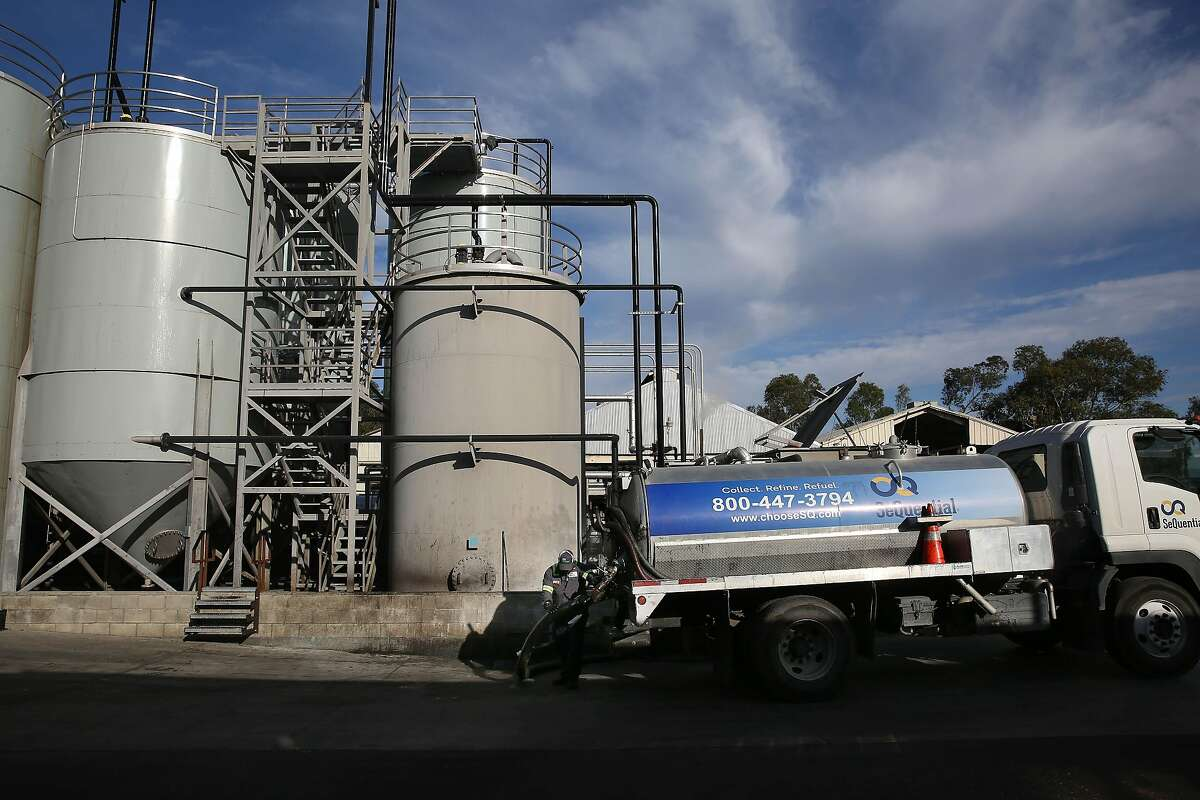 Jeff Buckles, tank farm supervisor, works on offloading cooking oil at the SeQuential biodiesel site in Salinas.