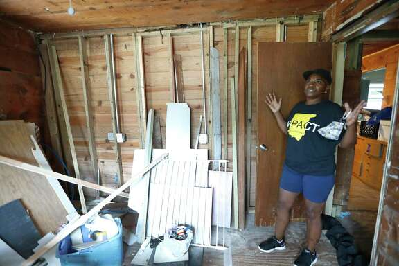 "Sandra Edwards stands in a room in her home which still has mold growing, Wednesday, August 26, 2020, in Houston, which is still damaged from Hurricane Harvey, three years ago. ""The Harvey Forgotten Survivors Caucus, a group of 15 to 25 home repair applicants that have been working since October of last year trying to help each other get their homes back together and demanding better service and equitable outcomes from the city's housing department and Texas General Land Office"
