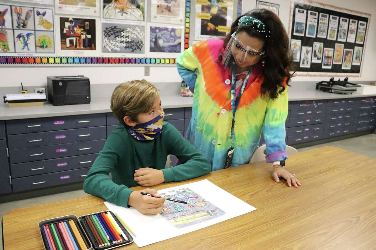 Davidson Elementary fifth grader Nico Colosio and his art teacher, Vanina Orendorff, talk about his drawing that was selected to hang in the Katy Independent School District Virtual Student Art Gallery.