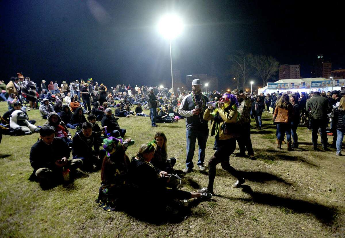 Revelers take in the festivities as Mardi Gras continues in downtown Beaumont Saturday. Photo taken Saturday, February 22, 2020 Kim Brent/The Enterprise