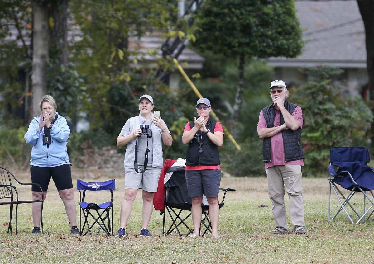 Homeowners and golf fans react to a shot from their yard during Round 2 of the 75th Annual U.S. Women's Open at Champions Golf Club in Houston on Friday, Dec. 11, 2020.