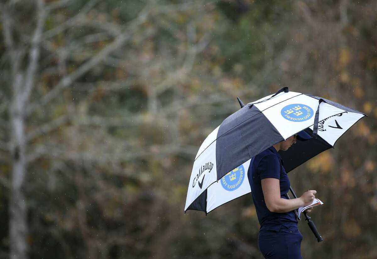 Linn Grant, an amateur from Australia, takes notes in the rain after completing the 10th hole of the Jackrabbit Course during Round 2 of the 75th Annual U.S. Women's Open at Champions Golf Club in Houston on Friday, Dec. 11, 2020.