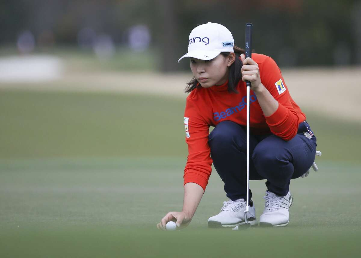 Hinako Shibuno of Japan lines up her putt at Jackrabbit Course for Round 2 of the 75th Annual U.S. Women's Open at Champions Golf Club in Houston on Friday, Dec. 11, 2020.