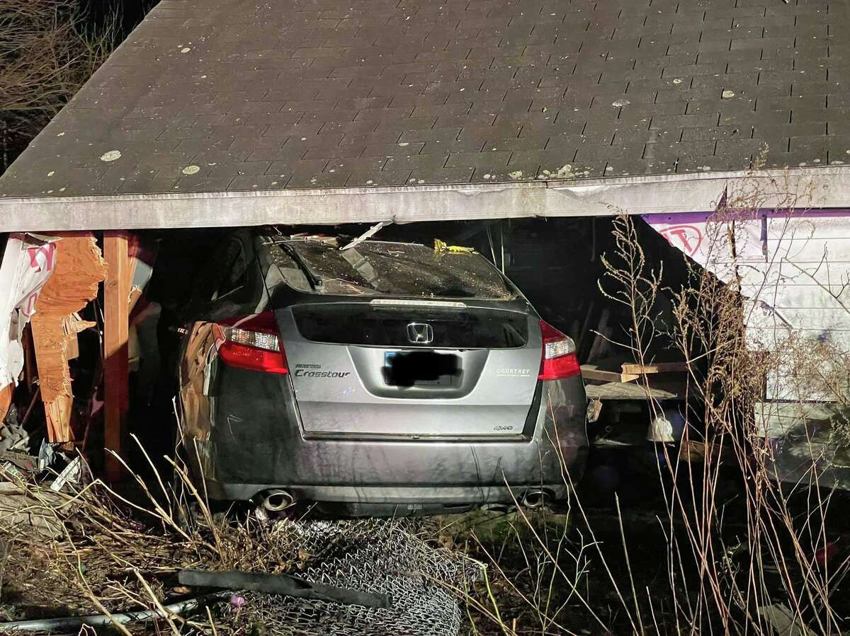 A person was rescued after crashing a vehicle into an Elm Street garage in Stratford on Thursday night on Dec. 10, 2020. The driver, who had a