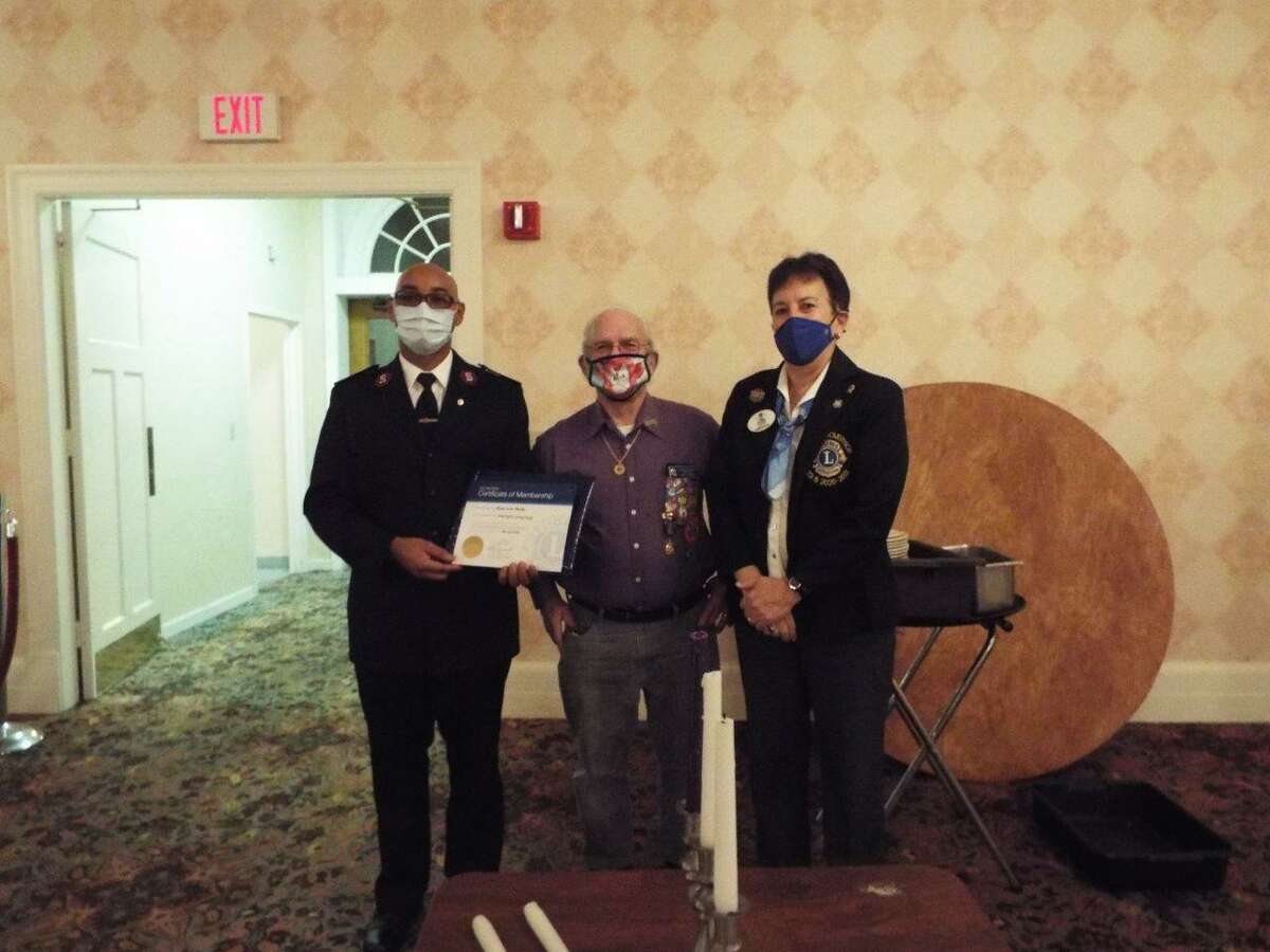 The Lions Club recently welcomed new members. Lt. Apolinar Marte was sponsored by club secretary Phil Dzurnak and installed by District Governor Heidi Zacchera.