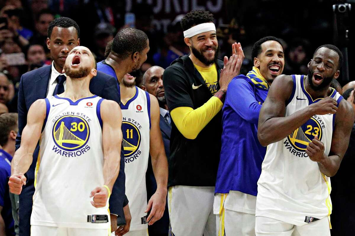 The Warriors' Stephen Curry (left) sounds off after Golden State beat Cleveland in game 4 of The NBA Finals in 2018.
