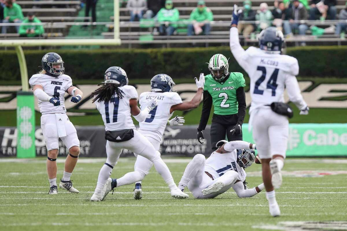 A flock of Owls celebrates one of Rice's five interceptions in its 20-0 upset victory at Marshall last week.