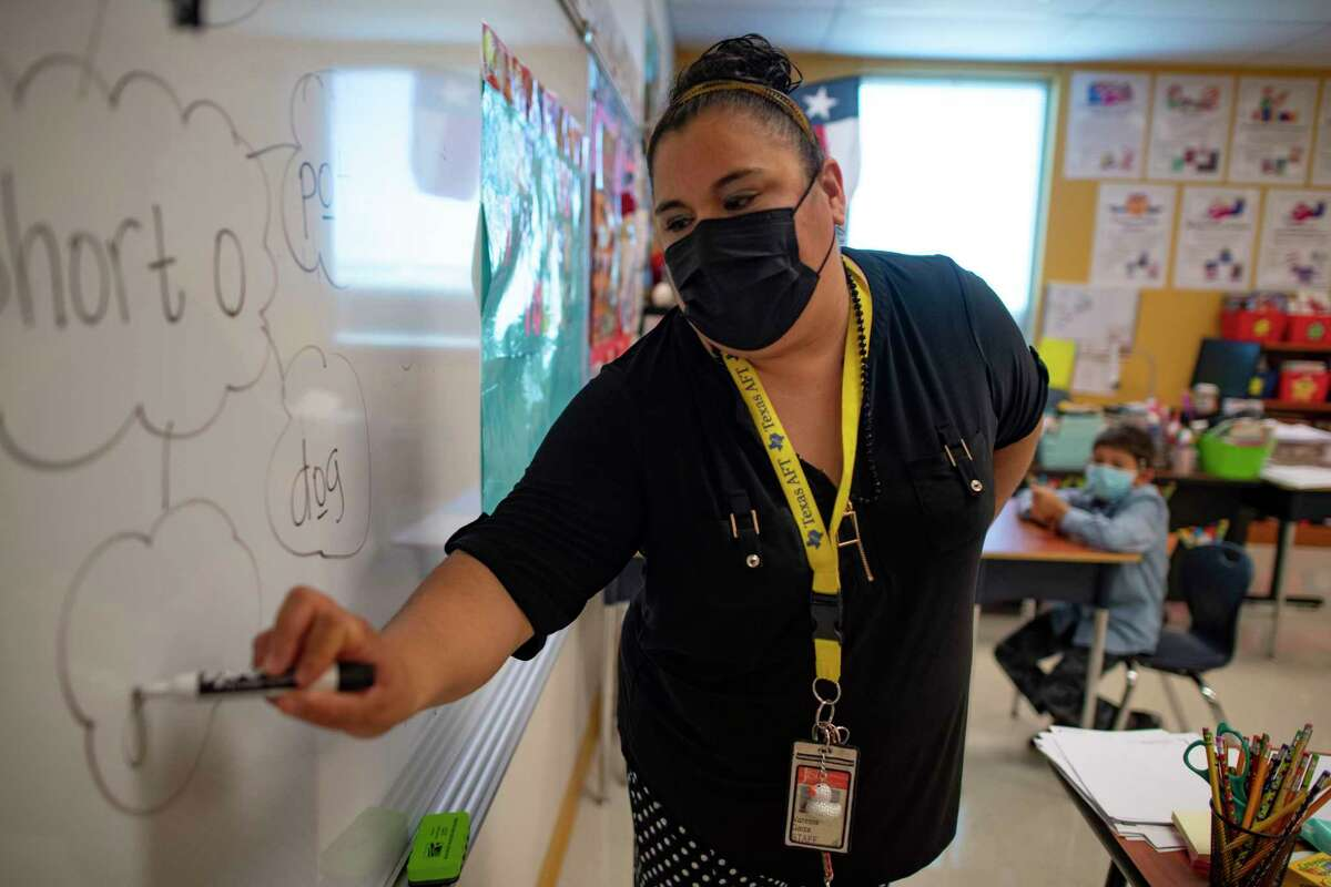 Vanessa Garza, an intervention teacher at Copperfield Elementary School in Judson ISD, works with students on Thursday.