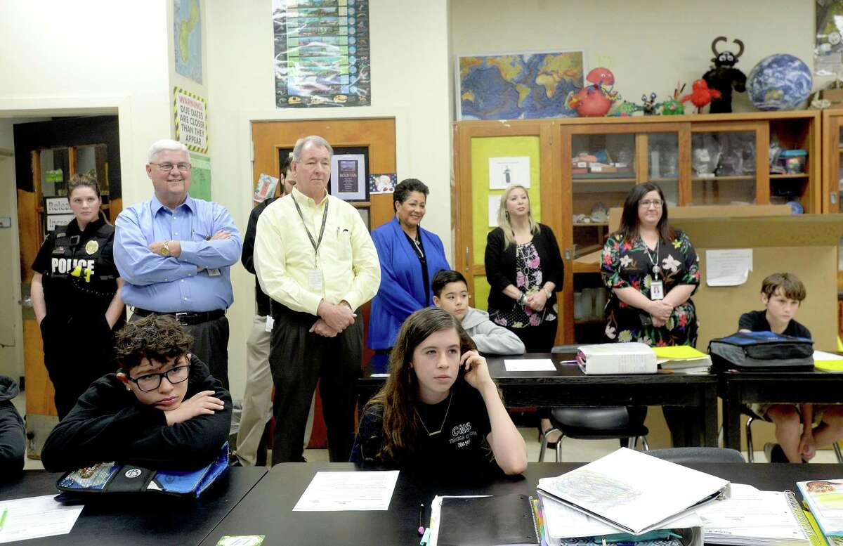 Students and Nederland ISD staff look on as Central Middle School science teacher Susan Ellis is surprised with the news that she won an H-E-B state-wide Excellence in Education Award and is presented with a check for $1,000 in her classroom Tuesday morning. H-E-B will match the award with a $1,000 grant to the school, as well. Ellis will go on to compete in the grandprize round, with the award of $25,000. Among the 30 schools across Texas to win, Ellis was the sole winner from the Southeast Texas region this year. Photo taken Tuesday, February 18, 2020 Kim Brent/The Enterprise